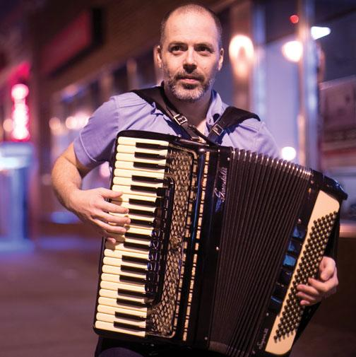 Rob Curto '91 takes his accordian ­outside after a November performance at Terraza 7 in Queens, N.Y.