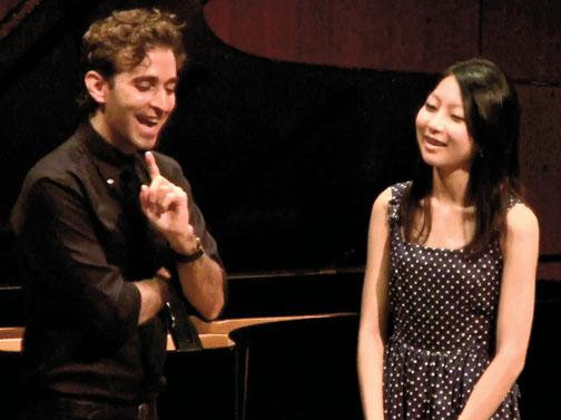 Anthony Roth Costanzo '04 offers a suggestion to soprano Lydia Lim '15.