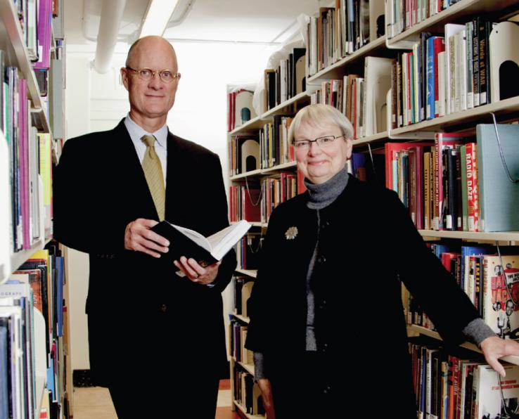 Librarian Karin Trainer (right) and University Architect Ron McCoy *80 review new shelving planned for Firestone Library as part of its forthcoming renovation.