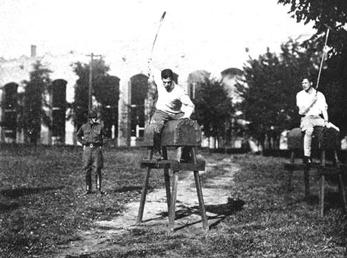 Students hone their technique as polo coach Maj. F.B. Prickett watches, in this photo believed to be from the late 1920s.