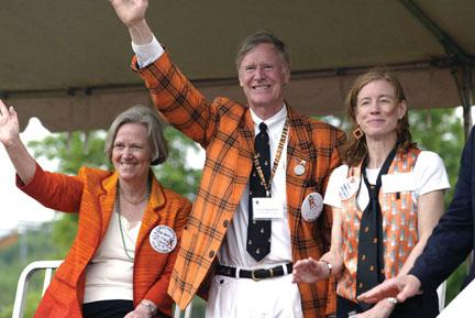 From left, President Tilghman, Alumni Association President David Siegfried '64, and Vice President Anne Sherrerd *87 greet the classes at the reviewing stand.