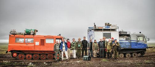 Members of the July 2011 expedition to Russia stand in front of trucks fitted with tank treads to crawl across the permafrost; from left, Bogdan Makovskii, Glenn MacPherson *81, Will Steinhardt, Chris Andronicos *99, Marina Yudovskaya, Luca Bindi, Victor