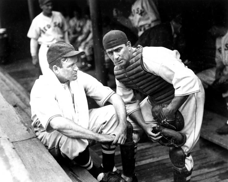 Moe Berg '23 and player-manager Joe Cronin in the Boston Red Sox dugout, circa 1937. Berg played in the major leagues for 15 seasons, mostly as a backup catcher, compiling a .243 lifetime batting average.