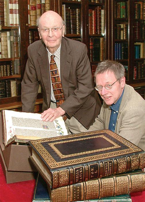 In this 2002 photo, William H. Scheide '36 (standing) and Scheide Librarian Paul Needham look over some of the first printed editions of the Bible, which are part of the magnificent collection of rare books and manuscripts that now have a permanent home