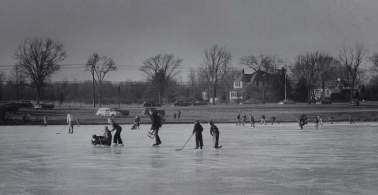 Elizabeth Menzies captured this view of ice skating on Lake Carnegie in 1951. A version of the photo ran in PAW's Jan. 26, 1951, issue and identified the man in the sled as Gordon Sikes '16 *17.