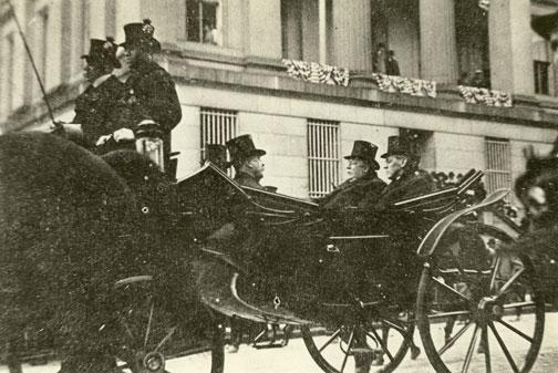 Wilson and Taft share a carriage on inauguration day in 1913.